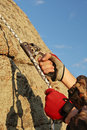 Hands of climber working with equipment on rock. Stock Photography