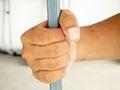 Hands clutching bars