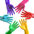 Hands colorful circle reaching inwards a bottom view of a circular group of glossy multicolored towards each other on an isolated Stock Photography