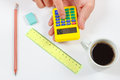 Hands compute using a pocket calculator over a workplace of engineer the Royalty Free Stock Photo
