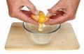 Hands cracking egg