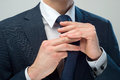 Hands cravat businessman dressed up the knot of his Royalty Free Stock Photos