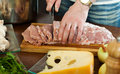 Hands cutting raw meat cooking french style Royalty Free Stock Photos