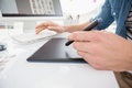 Hands of designer typing on keyboard and using digitizer in the office Royalty Free Stock Photos