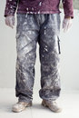 Hands dirty trousers of plastering painter man Royalty Free Stock Photo
