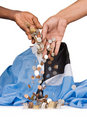 Hands dropping coins on pile Royalty Free Stock Photos