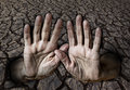 Hands and dry earth Royalty Free Stock Photo