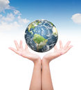 Hands with earth elements of this image furnished by nasa Royalty Free Stock Photo