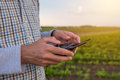 Hands of farmer using drone remote control Royalty Free Stock Photo