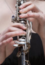 Hands of female musician playing clarinet young Royalty Free Stock Photography