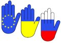 Hands with flags silhouettes of button of ukraine and russia Stock Photography