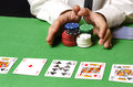Hands in foreground betting poker Royalty Free Stock Image