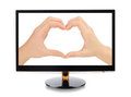 Hands forming a heart  in monitor Royalty Free Stock Photography