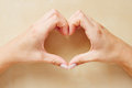 Hands forming a heart shape female with the fingers Royalty Free Stock Images