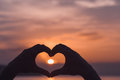 Hands forming a heart shape with sunset Royalty Free Stock Photo