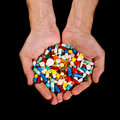 Hands full of pills Royalty Free Stock Photo