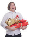 Hands full of presents Royalty Free Stock Image