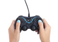 Hands with gamepad isolated on white background