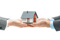 Hands giving house model to other hands concept of real estate and deal Stock Photos