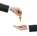 Hands and golden key Royalty Free Stock Photo