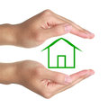 Hands and green house small on white background Royalty Free Stock Photography