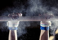 Hands of gymnast with chalk on uneven bars Royalty Free Stock Photo