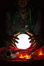 Hands from gypsy fortune teller above magic crystal ball Royalty Free Stock Photo