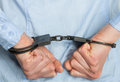 Hands in handcuffs on white background Stock Images