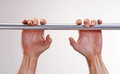 Hands hanging a metallic bar perseverance concept Stock Photo
