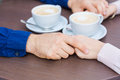 Hands of happy loving couple in a restaurant Royalty Free Stock Photo