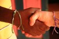 Hands and hearts unite in friendship across the sea bracelets adorn wrists of friends from us to haiti Stock Photos