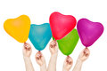 Hands hold color balloons in the shape of heart Royalty Free Stock Photos