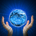 Hands hold glowing Earth. Hi-tech background Royalty Free Stock Photo