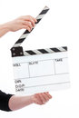 Hands holder film slate female holding an open clapperboard on a white background Royalty Free Stock Photo