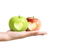 Hands holding apple a in hand Stock Photos