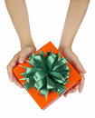 Hands holding beautiful gift box female giving christmas holidays and greeting season concept shallow dof Royalty Free Stock Images