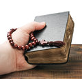 Hands holding the Bible and praying Royalty Free Stock Images
