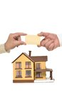 Hands holding blank card real estate concept at miniature house Royalty Free Stock Image