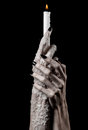 Hands holding a candle a candle is lit black background solitude warmth in the dark hands death hands witch studio Stock Images
