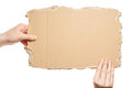 Hands holding cardboard Stock Photo