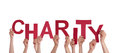 Hands holding charity many the red word isolated Royalty Free Stock Photography