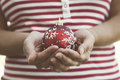 Hands holding a christmas ball of woman red Royalty Free Stock Images