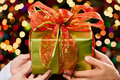 Hands holding Christmas present Royalty Free Stock Image