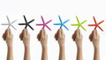 Hands holding colored starfish Royalty Free Stock Images
