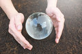 Hands holding earth made from glass Royalty Free Stock Photo