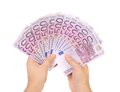 Hands holding euros banknotes isolated on a white Royalty Free Stock Photography
