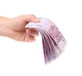 Hands holding euros banknotes isolated on a white background Royalty Free Stock Photo