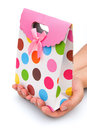 Hands holding a gift box side view on white with clipping path Royalty Free Stock Images
