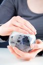 Hands holding a glass globe Royalty Free Stock Photography
