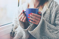 Hands holding hot cup of coffee or tea Royalty Free Stock Photo